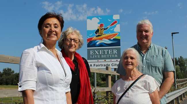 Members of the Steering Group in front of our new city signs